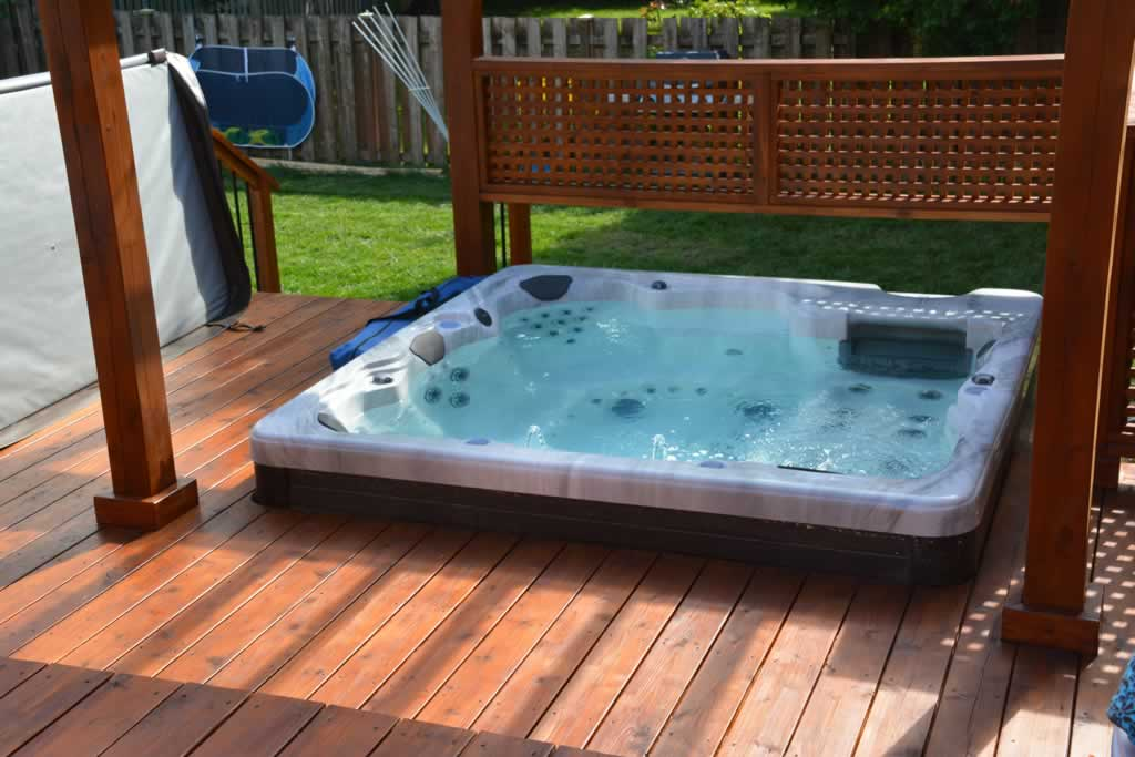 A deck can be built to accommodate a spa tub for an added feature ...